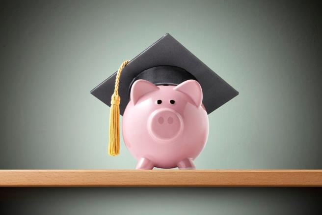 Education savings. Piggy bank with graduation cap.