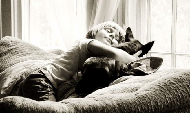 Little Girl Hugging Her Dog Near Window, Sepia Toned