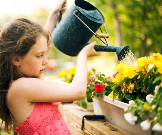 girl watering the flowers